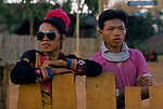 Hmong village, Pa Kludy, Northern Thailand SE Asia. Men in traditional every day clothes and western influence clothes. Wearing a pair of  stylish Aviator style sunglasses. 1990s