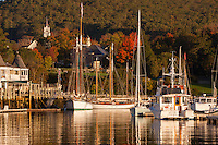 Sailboats rest at anchor shortly after sunrise in Camden Harbor, Camden, Maine