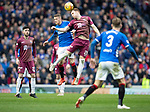 Rangers v St Johnstone…16.02.19…   Ibrox    SPFL<br />Liam Craig gets above Steven Davis<br />Picture by Graeme Hart. <br />Copyright Perthshire Picture Agency<br />Tel: 01738 623350  Mobile: 07990 594431
