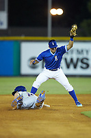 Jarred Kelenic (20) of the Kingsport Mets dives back into second base as Jose Marquez (4) of the Burlington Royals waits for a pick-off throw at Burlington Athletic Stadium on July 27, 2018 in Burlington, North Carolina. The Mets defeated the Royals 8-0.  (Brian Westerholt/Four Seam Images)