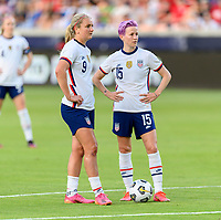HOUSTON, TX - JUNE 10: Lindsey Horan #9 and Megan Rapinoe #15 of the United States talk strategy before taking a penalty kick during a game between Portugal and USWNT at BBVA Stadium on June 10, 2021 in Houston, Texas.