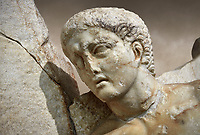 Close up of a Roman Sebasteion relief  sculpture of Orestes At Delphi Aphrodisias Museum, Aphrodisias, Turkey.   <br /> <br /> Orestes who has sought sanctuary at Delphi after murdering his mother, leaves Apollo's shrine on his way to stand trial in Athens, The hero steps gingerly over sleeping Fury; he brandishes a sword and still hold onto Apollo's tripod. The Fury has a snake and a burning torch with which she torments male factors. A small local nymph sits above on a rocky outcrop of Delphi's Mt Parnossos