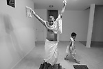 Arajav Patel, 6, paces around his grandfather, Babulal Patel, during a Hindu meditation and prayer ritual called Puja that the family, originally from India, practices every morning in their Durham home. Puja consists of meditations, chanting, Scripture readings, prostrations and food offerings, all honoring a single God.