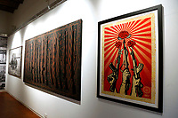 The screen printing titled 'Guns and Roses' at the Exhibition '3 Decades of Dissent' of the urban artist Shepard Fairey at the modern art gallery of Rome.<br /> Rome (Italy), September 17th 2020<br /> Photo Samantha Zucchi Insidefoto