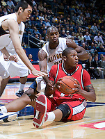 11 November 2009:  Eli Holman of Detroit controls the ball away from California defenders during the game at Haas Pavilion in Berkeley, California.   California defeated Detroit, 95-61.