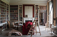 One end of the library will eventually be furnished as a comfortable sitting area when restoration work in the room is completed