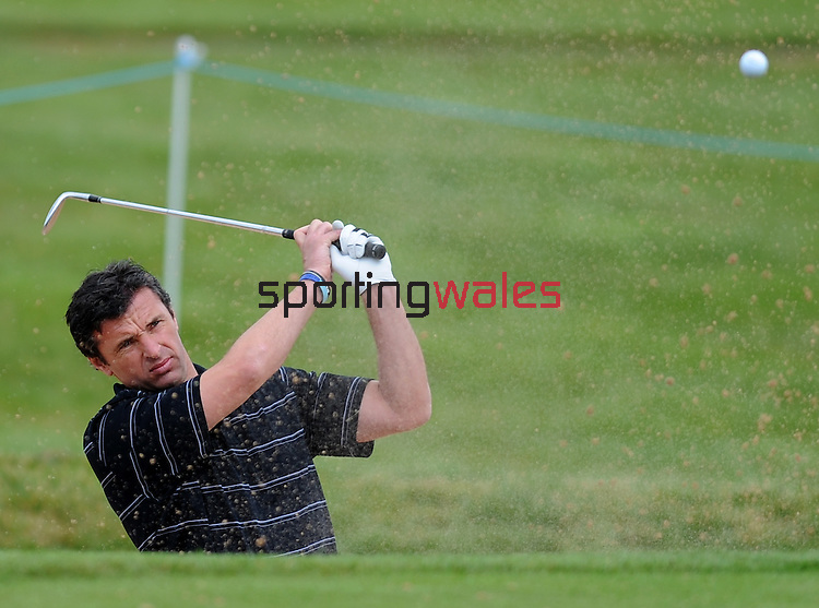 Wales football Manager Gary Speed hits a shot out of the bunker on the 10th ..Golf - SAAB Wales Open - Pro Am - Wednesday  1st June  2011 - Celtic Manor Resort,  - Newport..© www.sportingwales.com- PLEASE CREDIT IAN COOK