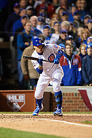 Chicago Cubs Javier Baez (9) squares to bunt in the fourth inning during Game 5 of the Major League Baseball World Series against the Cleveland Indians on October 30, 2016 at Wrigley Field in Chicago, Illinois.  (Mike Janes/Four Seam Images)