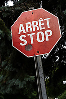 "One of the last French-English bilingual ""stop"" sign is seen on Rue de Berniere street in Quebec city July 7, 2009. Provincial government changed (almost) all the stop sign to only read ""arret"" many years ago.<br /> <br /> PHOTO :  Francis Vachon - Agence Quebec Presse"