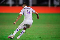 LAKE BUENA VISTA, FL - JULY 20: Joao Moutinho #4 of Orlando City SC kicks the ball during a game between Orlando City SC and Philadelphia Union at Wide World of Sports on July 20, 2020 in Lake Buena Vista, Florida.