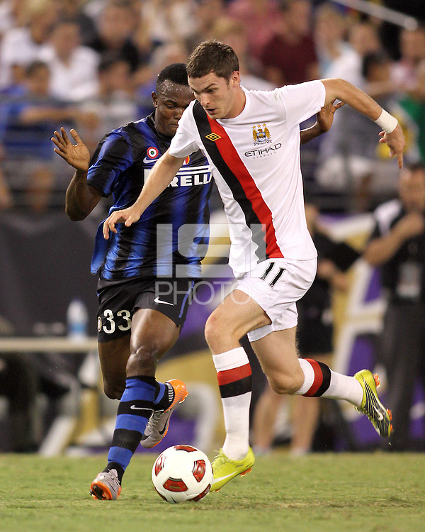 Nsofor Victor Obinna #33 of Inter Milan closes in on Adam Johnson #11 of Manchester City during an international friendly match on July 31 2010 at M&T Bank Stadium in Baltimore, Maryland. Milan won 3-0.
