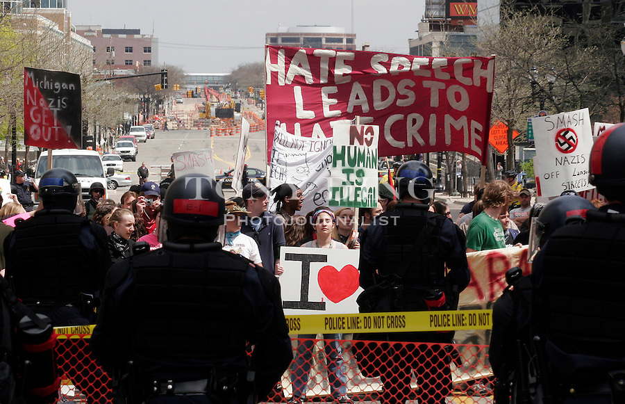 The Lansing Committee Against Nazis (LCAN), made up of mostly area high school students, protest a National Socialist Movement (Neo-Nazi) rally on the steps of the Michigan State Capitol, on Saturday, April 22, 2006 in Lansing, MI. (AP Photo/Tony Ding)