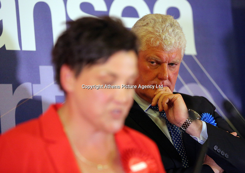 Pictured: Conservative candidate Byron Davies (R) looks on as Labour candidate for Gower constituency Tonia Antoniazzi gives a speech after her win was announced.  Friday 09 June 2017<br /> Re: Counting of ballots at Brangwyn Hall for the general election in Swansea, Wales, UK