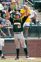 Baylor Bears outfielder Dan Evatt #23 gestures to his dugout after he tripled during the NCAA Regional baseball game against Oral Roberts University on June 3, 2012 at Baylor Ball Park in Waco, Texas. Baylor defeated Oral Roberts 5-2. (Andrew Woolley/Four Seam Images)