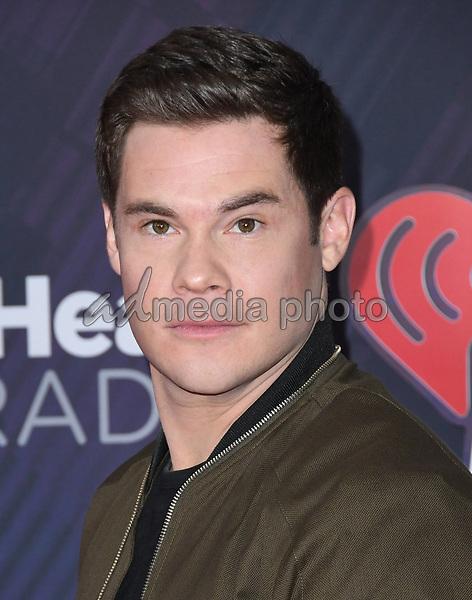 11 March 2018 - Inglewood, California - Adam Devine. 2018 iHeart Radio Awards held at The Forum. Photo Credit: Birdie Thompson/AdMedia