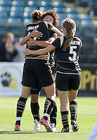 Christine Sinclair (12), Eriko Arakawa (center), and Tina DiMartino (5) celebrate after Sinclair's goal in the first half with an assist from Arakawa. FC Gold Pride and Chicago Red Stars tied 1-1 at Buck Shaw Stadium in Santa Clara, California on June 7, 2009.