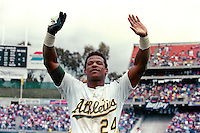 OAKLAND, CA - Rickey Henderson of the Oakland Athletics waves to the fans after setting the all time career stolen base record by stealing base #939 during a game against the New York Yankees at the Oakland Coliseum in Oakland, California on May 1, 1991. Photo by Brad Mangin