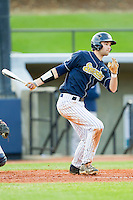 Christian Wolfe (21) of the UNCG Spartans follows through on his swing against the Georgia Southern Eagles at UNCG Baseball Stadium on March 29, 2013 in Greensboro, North Carolina.  The Spartans defeated the Eagles 5-4.  (Brian Westerholt/Four Seam Images)