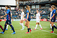TACOMA, WA - JULY 31: Cece Kizer #5 of Racing Louisville FC waves at Sofia Huerta #11 of the OL Reign before a game between Racing Louisville FC and OL Reign at Cheney Stadium on July 31, 2021 in Tacoma, Washington.