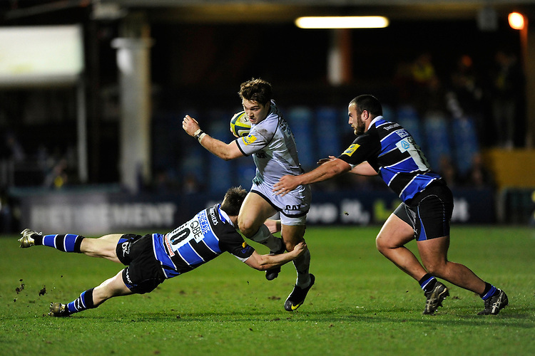 Alex Lewington of Leicester Tigers (centre) is tackled by Tom Heathcote (left) and Charlie Beech of Bath Rugby during the LV= Cup semi final match between Bath Rugby and Leicester Tigers at The Recreation Ground, Bath (Photo by Rob Munro, Fotosports International)