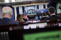 -White House Press Secretary Jen Psaki talks to reporters during the daily press briefing in the Brady Press Briefing Room of the White House on Tuesday, April 6, 2021 in Washington, DC.<br /> Credit: Oliver Contreras / Pool via CNP /MediaPunch
