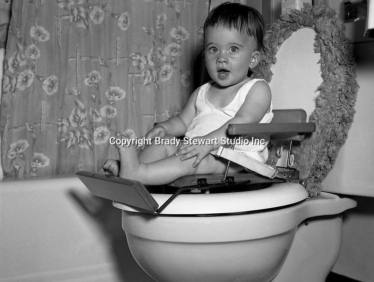 Pleasant Hills PA: Members of both Brady Stewart and Brady Stewart Jr.'s families were occasionally used as models for advertising products. And the pay was way below minimum wage!<br /> <br /> Cathleen Brady Stewart learning with the new Cher-Chair Nursery Seat.  Cathleen is the oldest child of Brady Stewart Jr and Marjorie Zapp Stewart.