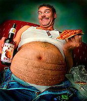"Spare tire - a man with a huge beer belly that bursts out of his blue jeans holds a """"big belly beer"""" in one hand and a slice of pizza in the other Billboard and broadcast must be negotiated, due to talent agreement. United States."