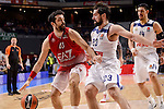 Real Madrid's Sergio Llull and Gustavo Ayon and EA7 Emporio Armani Milan's Krunoslav Simon during Turkish Airlines Euroleage match between Real Madrid and EA7 Emporio Armani Milan at Wizink Center in Madrid, Spain. January 27, 2017. (ALTERPHOTOS/BorjaB.Hojas)