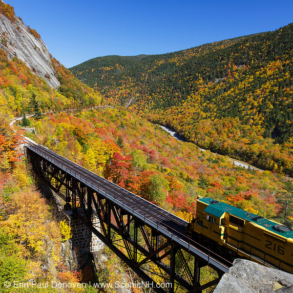 """The """"Notch Train"""" represents October in the 2019 White Mountains New Hampshire calendar. This scene shows the Conway Scenic Railroad's """"Notch Train"""" crossing the Willey Brook Trestle along the old Maine Central Railroad in Hart's Location, New Hampshire. Purchase a copy of the calendar here: http://bit.ly/2GPQ9q3"""