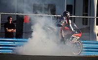 Jason DiSalvo performs a burnout after winning the Daytona 200 motorcycle race at Daytona International Speedway, Daytona Beach, FL, March 2011.(Photo by Brian Cleary/www.bcpix.com)