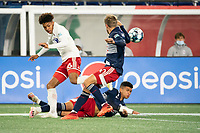 FOXBOROUGH, MA - OCTOBER 16: Damian Rivera #72 of New England Revolution II tackles Justin Che #46 of North Texas SC during a game between North Texas SC and New England Revolution II at Gillette Stadium on October 16, 2020 in Foxborough, Massachusetts.