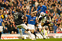 11/11/2006       Copyright Pic: James Stewart.File Name :sct_jspa01_rangers_v_dunfermline.CHARLIE ADAMS TAKES THE BALL AWAY FROM BAMBA.James Stewart Photo Agency 19 Carronlea Drive, Falkirk. FK2 8DN      Vat Reg No. 607 6932 25.Office     : +44 (0)1324 570906     .Mobile   : +44 (0)7721 416997.Fax         : +44 (0)1324 570906.E-mail  :  jim@jspa.co.uk.If you require further information then contact Jim Stewart on any of the numbers above.........