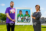 Artist Maureen O'Mahoney presents a painting to Derek O'Connor of the Tír na nÓg  orphanage for their fundraiser called The Lads, of twins Holy and his brother Honory who are orphaned twins in Tanzania and the fundraising raffle will be held in early July. L to r: Derek O'Connor and Maureen O'Mahoney