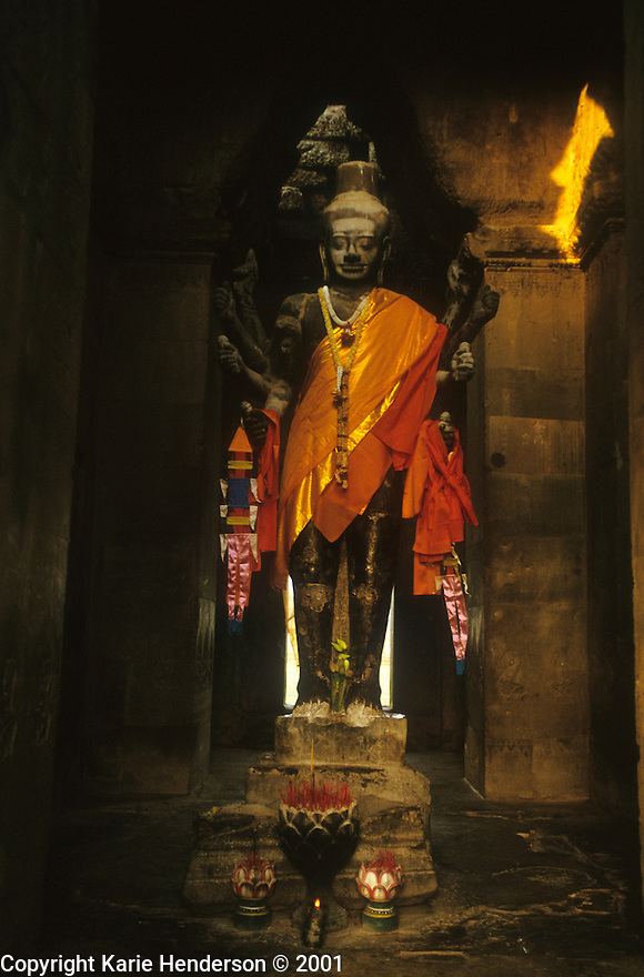 A Buddhist statue within Angkor Wat, Siem Reap, Cambodia. Photo by, Karie Henderson © 2001