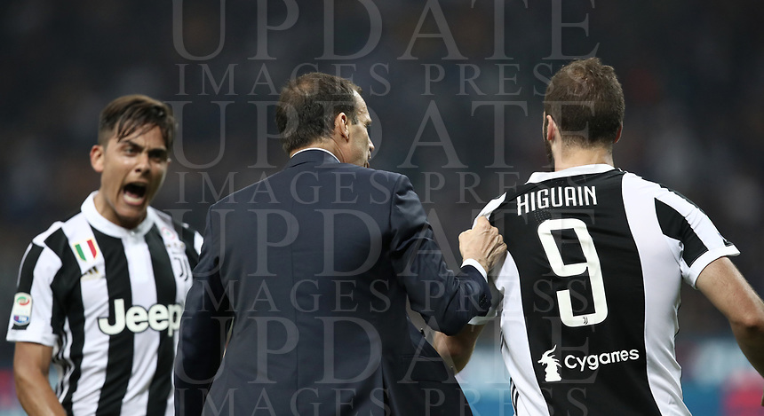 Calcio, Serie A: Inter - Juventus, Milano, stadio Giuseppe Meazza (San Siro), 28 aprile 2018.<br /> Juventus' Gonzalo Higuain (r) and Paulo Dybala (l) with Juventus coach Massimiliano Allegri (c) during the Italian Serie A football match between Inter Milan and Juventus at Giuseppe Meazza (San Siro) stadium, April 28, 2018.<br /> UPDATE IMAGES PRESS/Isabella Bonotto