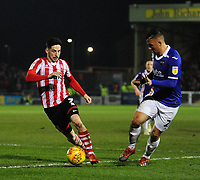Lincoln City's Tom Pett vies for possession with Exeter City's Kane Wilson<br /> <br /> Photographer Andrew Vaughan/CameraSport<br /> <br /> The EFL Sky Bet League Two - Lincoln City v Exeter City - Tuesday 26th February 2019 - Sincil Bank - Lincoln<br /> <br /> World Copyright © 2019 CameraSport. All rights reserved. 43 Linden Ave. Countesthorpe. Leicester. England. LE8 5PG - Tel: +44 (0) 116 277 4147 - admin@camerasport.com - www.camerasport.com