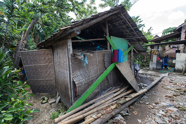 """5 April 2017, Surabaya,East Java,Indonesia: The goat shed where Febrianto, a 24 year old mental illness sufferer, was released from the chains he has been shackled to a stake for the past two years next to his family in Pehwetan village, East Java. Indonesian Social Affairs Dept. workers cut the bonds and washed his emaciated body and applied first aid before putting him in a strait jacket and taking him to a facility in Malang for treatment. Febrianto is a patient in a program called """"E- Shackling"""" which aims to free people suffering from mental illness, from the shackles that family often place them in to control them in the wake of a lack of treatment options and which will treat them and enter them in a data base allowing them to be traced before releasing them back to their families. Some people stay chained to a stake or in rooms for years by their families and not all families are willing to take their sick family members back. Picture by Graham Crouch/The Australian"""