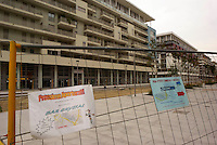 milano, nuovo quartiere rogoredo - santa giulia, periferia sud-est. pubblicità delle prime attività commerciali che aprono nel quartiere --- milan, new district rogoredo - santa giulia, south-east periphery. advertising of the first commercial activities that open in the district