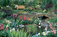 Beautiful garden with wooden bench, waterfall, pond, perennials, etc 4172C