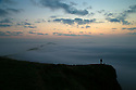 08/09/15<br /> <br /> ***WITH VIDEO***<br /> <br /> A man walks his dog to the summit of Mam Tor before dawn to witness a cloud inversion as mist shrouds the lower lying land of the Derbyshire Peak District near Edale.<br /> <br /> All Rights Reserved: F Stop Press Ltd. +44(0)1335 418629   www.fstoppress.com.