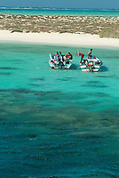 Fishermen on their boats in the bay of Siyul Island, Red Sea, Egypt.