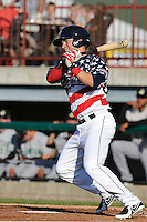 Tyler Palmer #12 of the Burlington Bees swings against the Clinton LumberKings at Community Field  on July 3, 2014 in Burlington, Iowa. The LumberKings beat the Bees 6-5.   (Dennis Hubbard/Four Seam Images)