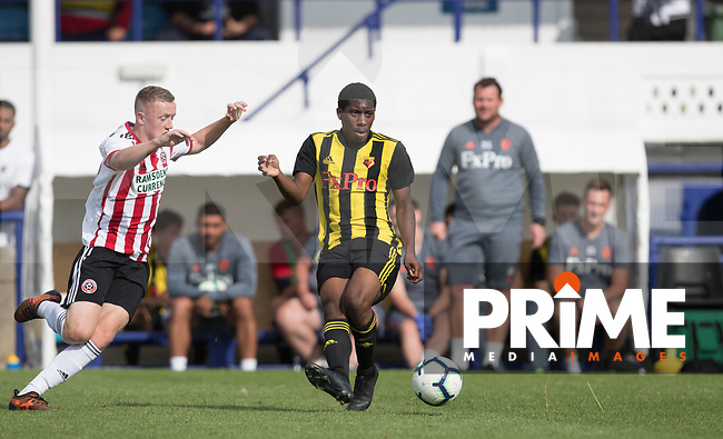 Michael Mullings of Watford under pressure from Jordan Hallam of Sheffield United during the Professonal Development League match between Watford U23 and Sheffield United U23 at The Maurice Rebak Stadium, Summers Lane, England on 17 August 2018. Photo by Andy Rowland.