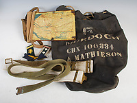 BNPS.co.uk (01202 558833)<br /> Pic: LindsayBurns/BNPS<br /> <br /> Pictured: Marine Jock Mathieson's map reading board and duffle bag.<br /> <br /> The medals, weapons and personal effects of a hero D-Day commando have sold for over £11,000 - 22 times their estimate.<br /> <br /> Marine Jock Mathieson narrowly escaped death during the Normandy landings on June 6, 1944.<br /> <br /> A bullet pierced the fuel tank of his motorbike which he was carrying above his head while wading through the sea towards Juno Beach.