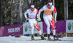 Sochi, RUSSIA - Mar 16 2014 - Brian McKeever and his guide Erik Carleton compete in Cross Country Skiing Men's 10km Free Visually Impaired at the 2014 Paralympic Winter Games in Sochi, Russia.  (Photo: Matthew Murnaghan/Canadian Paralympic Committee)
