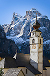 Italy, South Tyrol (Trentino-Alto Adige), Colfosco in Badia: parish church and Sella Group   Italien, Suedtirol (Trentino-Alto Adige), Kolfuschg (Colfosco in Badia): Pfarrkirche vor Sellagruppe