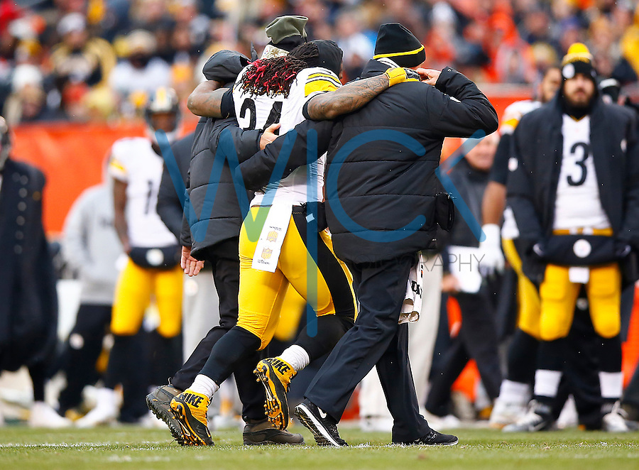 DeAngelo Williams #34 of the Pittsburgh Steelers is carried off of the field after injuring his ankle against the Cleveland Browns during the game at FirstEnergy Stadium on January 3, 2016 in Cleveland, Ohio. (Photo by Jared Wickerham/DKPittsburghSports)