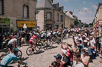 the peloton rolling through the town of  Réaumur<br /> <br /> Stage 2: Mouilleron-Saint-Germain > La Roche-sur-Yon (183km)<br /> <br /> Le Grand Départ 2018<br /> 105th Tour de France 2018<br /> ©kramon