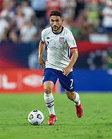 NASHVILLE, TN - SEPTEMBER 5: Cristian Roldan #7 of the United States dribbles during a game between Canada and USMNT at Nissan Stadium on September 5, 2021 in Nashville, Tennessee.