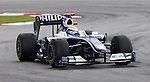 04 Apr 2009, Kuala Lumpur, Malaysia --- AT&T Williams driver Nico Rosberg of Germany steers his car during the third practice session ahead the 2009 Fia Formula One Malasyan Grand Prix at the Sepang circuit near Kuala Lumpur. Photo by Victor Fraile --- Image by © Victor Fraile / The Power of Sport Images